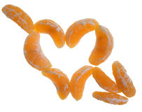 Tangerine heart. Slices of tangerine forming a heart symbol with arrow with clipping path Royalty Free Stock Photo