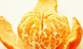 Tangerine on her skin Stock Photography
