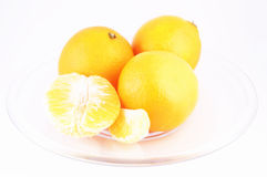 Tangerine isolated. Tangerines on plate isolated on white background Stock Photos