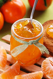 Tangerine jam in glass jar Royalty Free Stock Image