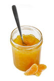 Tangerine jam with spoon Stock Photos