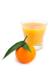 Tangerine and juice. Juice of a tangerine on a white background Royalty Free Stock Photos