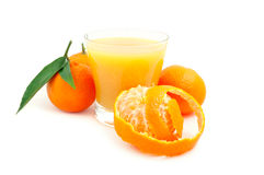 Tangerine and juice. Juice of a tangerine on a white background stock photos