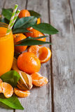 Tangerine juice background Stock Photos