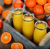 Tangerine juice. On brown background Royalty Free Stock Image