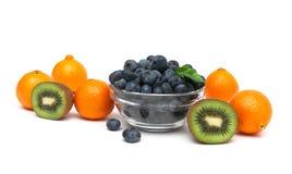 Tangerine, kiwi and blueberries on a white background Stock Image