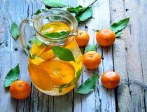 Tangerine lemonade. Tangerine and mint homemade lemonade royalty free stock images
