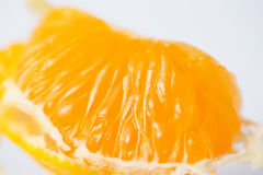 Tangerine macro. Slice of mandarin orange (tangerine) macro stock image