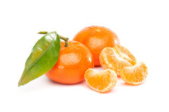 Tangerine, Mandarin. Group of fruits  with different names: Tangerine, mandarine or clementine. Full one and pieces Royalty Free Stock Images