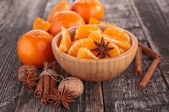 Tangerine or mandarin fruit and spices. On wood Stock Images