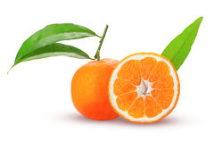 Tangerine or mandarin fruit whole and cut in half with green lea. Ves isolated on white background royalty free stock photo