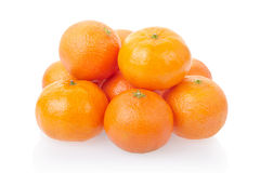 Tangerine or mandarin heap. On white, clipping path included Stock Photos