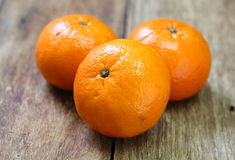 Tangerine, Mandarin honey orange on wood Royalty Free Stock Photos