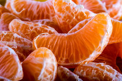 Tangerine or mandarin orange segments peeled close up background texture. Royalty Free Stock Photo