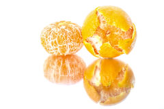 Tangerine on Mirror Surface Royalty Free Stock Photos