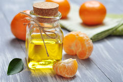 Tangerine oil in a glass bottle Royalty Free Stock Photos