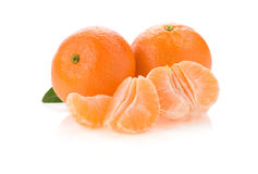 Tangerine orange fruit and slices on white. Background Stock Images