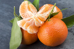 Tangerine. Orange mandarin or tangerine fruit with leaves Royalty Free Stock Photography