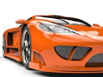 Tangerine orange modern super sports car - headlight extreme closeup shot Royalty Free Stock Photography