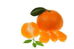 Tangerine oranges with segments and leaves Stock Photo