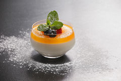 Tangerine panna cotta Stock Images