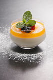 Tangerine panna cotta in glass Royalty Free Stock Image
