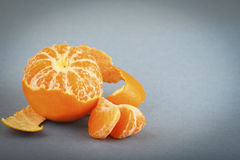 Tangerine with peeled skin Royalty Free Stock Images