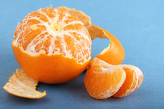 Tangerine with peeled skin Stock Photography