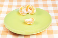 Tangerine on plate Royalty Free Stock Photography