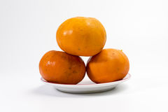 Tangerine on a plate having pink rim Royalty Free Stock Photo
