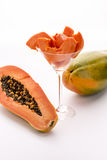 Tangerine pulp and peppery seeds - the Papaya. Wedges of papaya fruit pulp assorted in a long-stemmed glass Royalty Free Stock Images