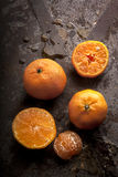 Tangerine on a rusty background Royalty Free Stock Photos