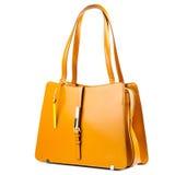 Tangerine rzemienna teczka odizolowywająca na białym tle zdjęcia royalty free