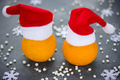 Tangerine in Santa hat Christmas Xmas New Year concept, fresh ri Royalty Free Stock Photography