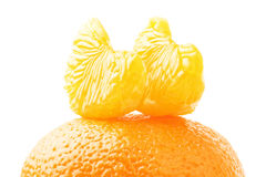 Tangerine sections isolated. Ripe bright tangerine sections isolated on white background Royalty Free Stock Image