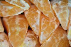Tangerine segments. Orange background texture Royalty Free Stock Images