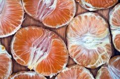 Tangerine segments. Orange background texture Royalty Free Stock Image