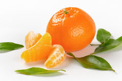Tangerine with separated segments Royalty Free Stock Photo