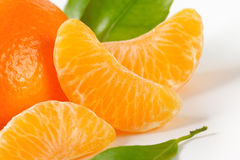 Tangerine with separated segments Royalty Free Stock Images