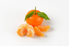 Tangerine with separated segments Royalty Free Stock Photos