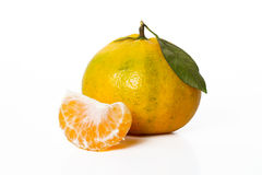 Tangerine and slice. An isolated tangerine/mandarin orange and a slice in white background Royalty Free Stock Photos