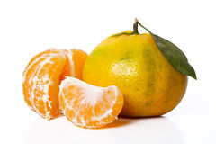 Tangerine and slices Royalty Free Stock Photo