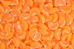 Tangerine slices close up as background Stock Photos