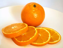 Tangerine and slices on white background Stock Photo