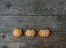 Tangerine slices on wooden background Stock Photos