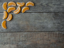 Tangerine slices on wooden background Stock Photo