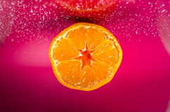 Tangerine space. Tangerine in space abstraction with purple background Stock Photo