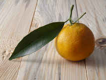 Tangerine on a table Royalty Free Stock Photography