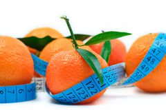 Tangerine and a tape Royalty Free Stock Images