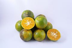 Tangerine [Thonburi]. Group of  tangerines split in a half on white background Royalty Free Stock Image